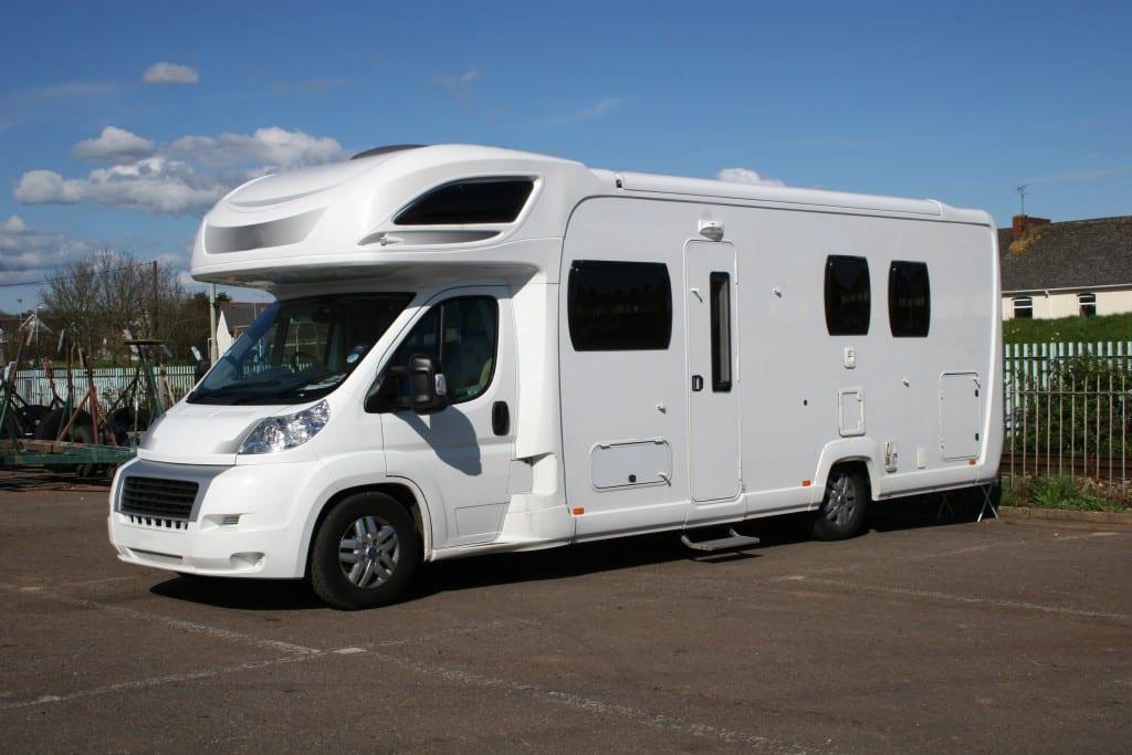 white camper van parked in coastal car park