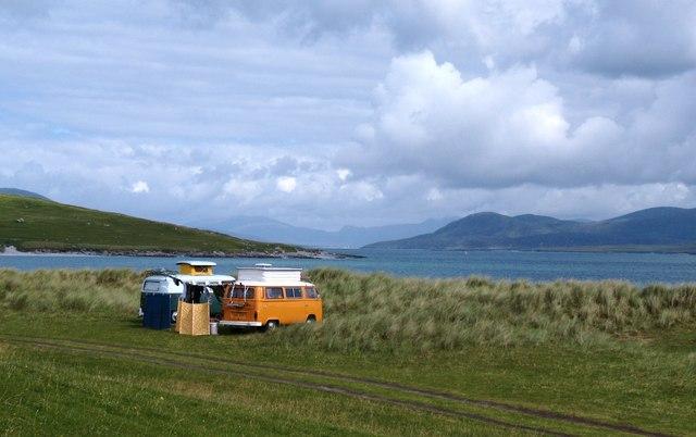 Camper vans by a lake