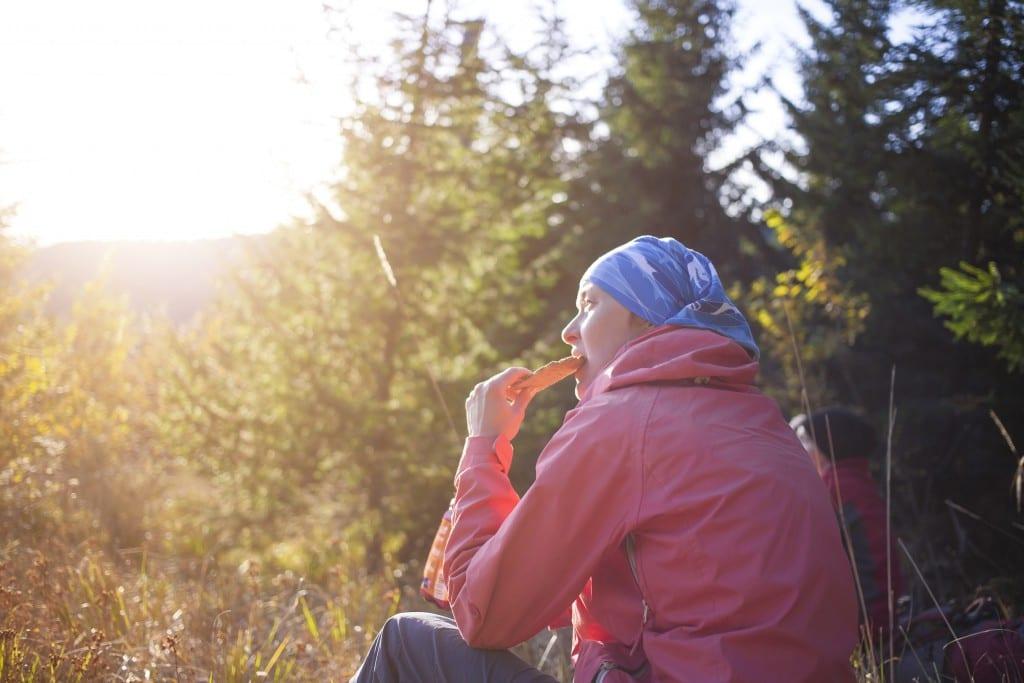 Woman hiker enjoying snack food